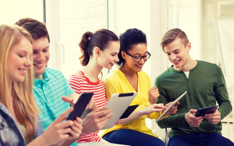 Students using tablets to take online courses